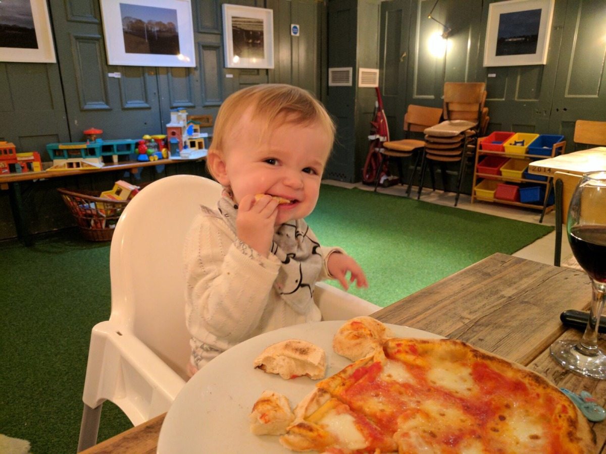 Enjoy bear-shaped pizza and vintage Fisher Price toys at Forest Gate's Corner Kitchen