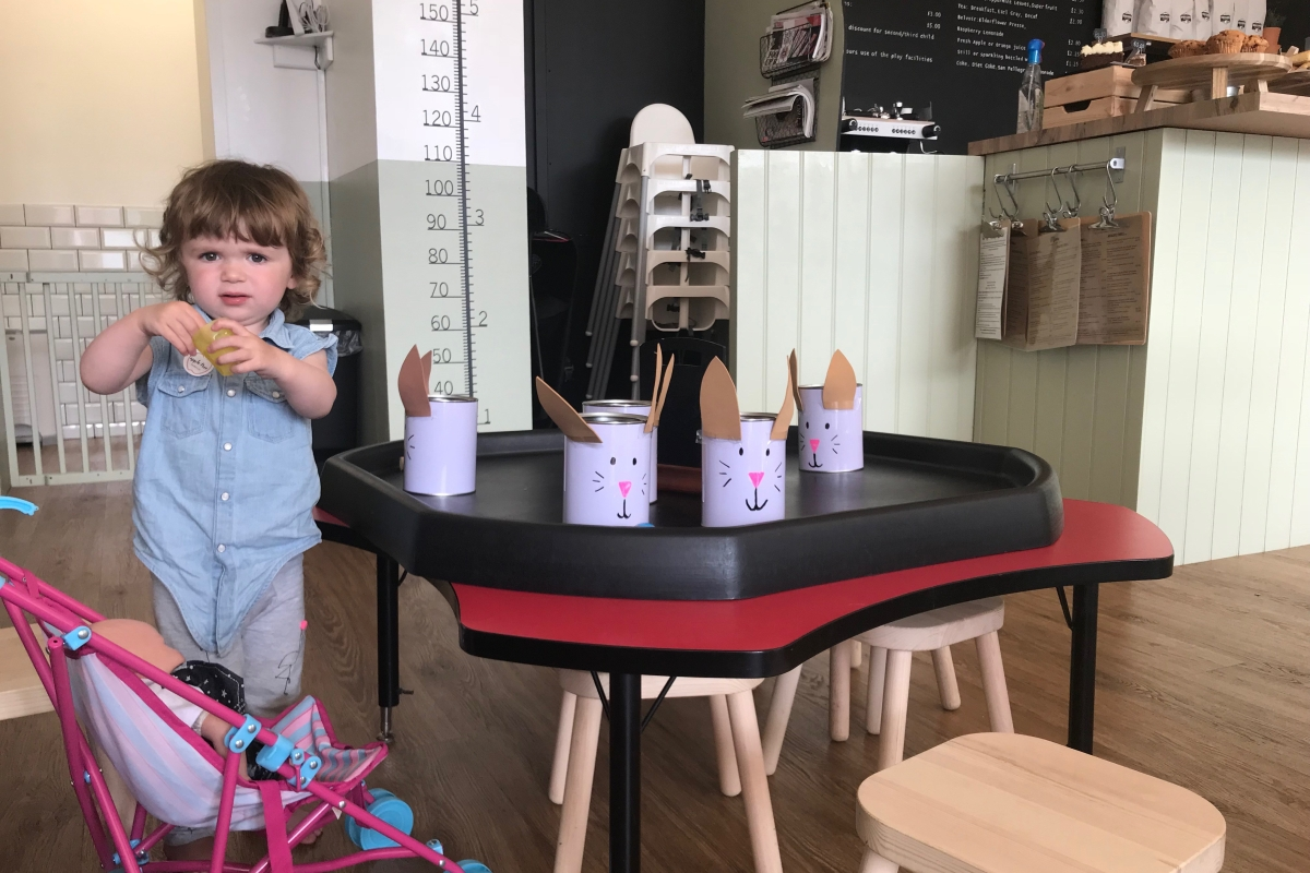 Sip a locally brewed latte while they lark around at Apple Tree Children's Cafe